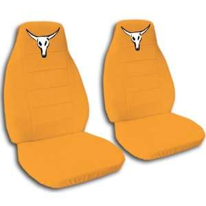 2 Orange Cow skull seat covers for a 1999 2001 Ford F